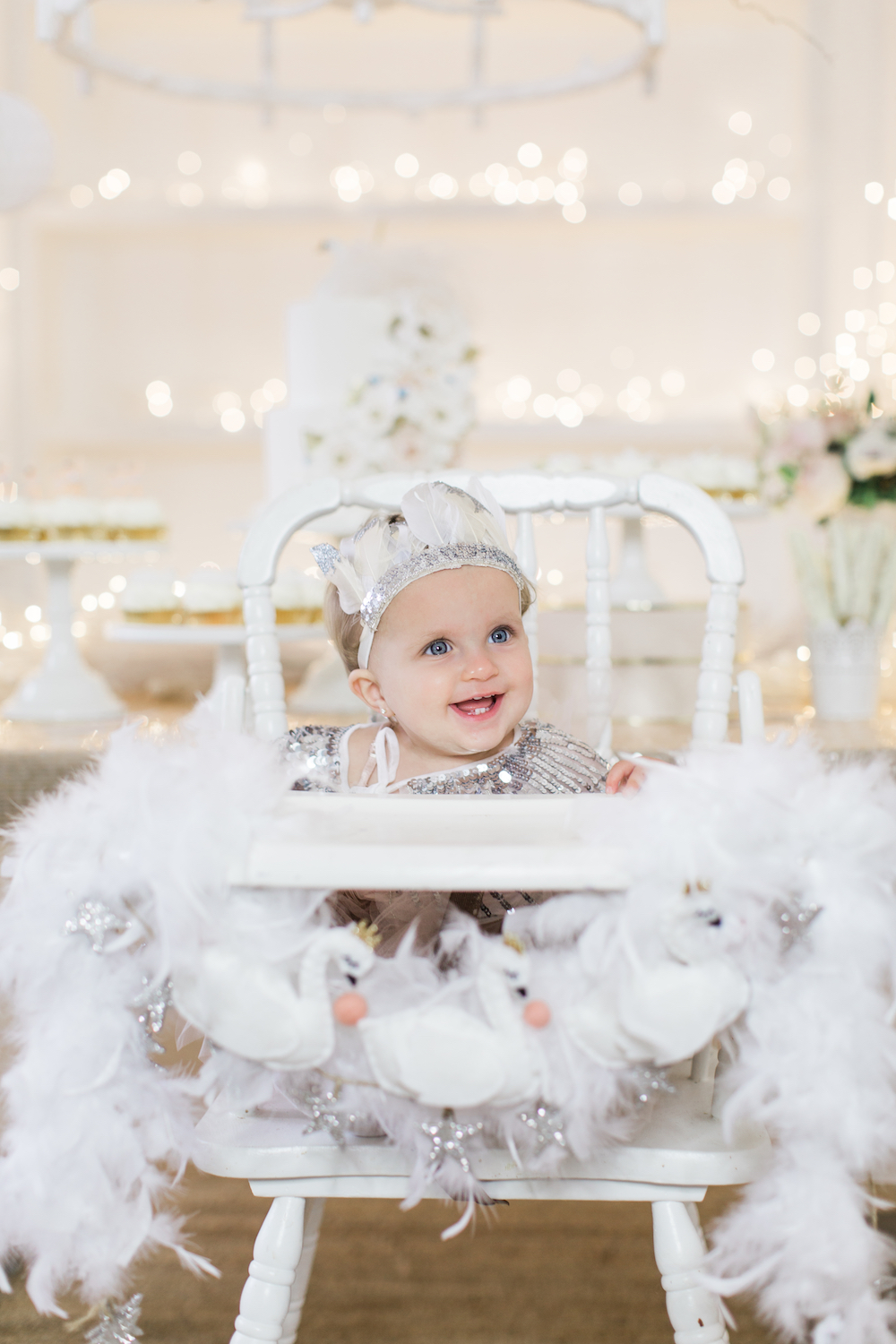 Baby girl's first swan lake birthday party