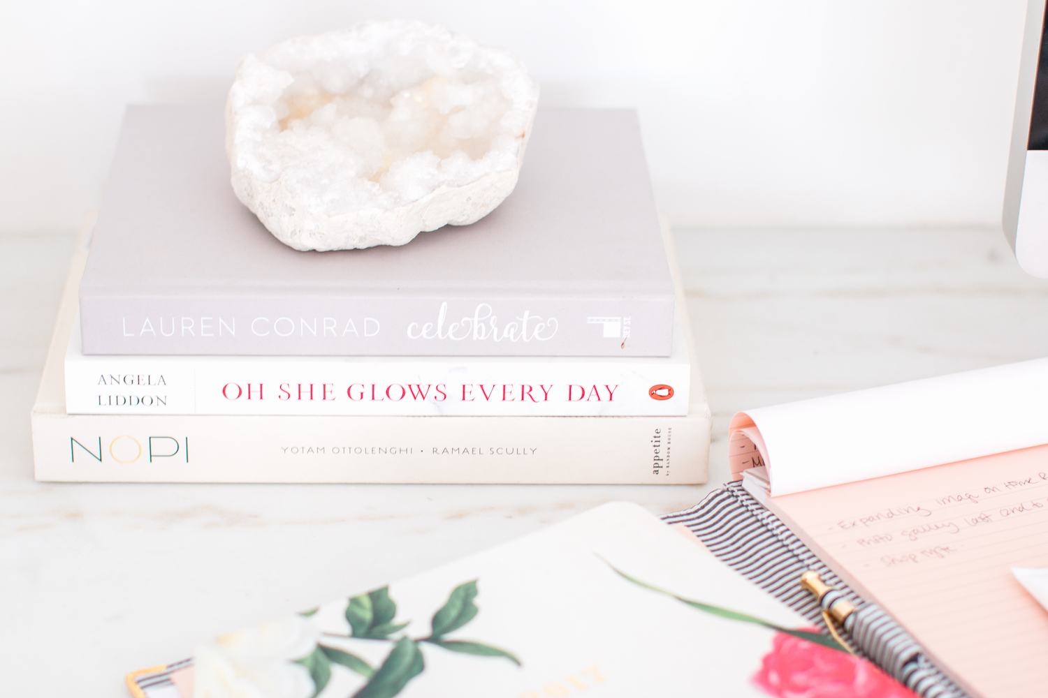 coffee table books and agenda on white marble