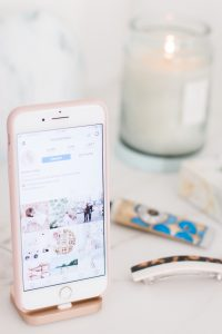 Iphone on white marble desk