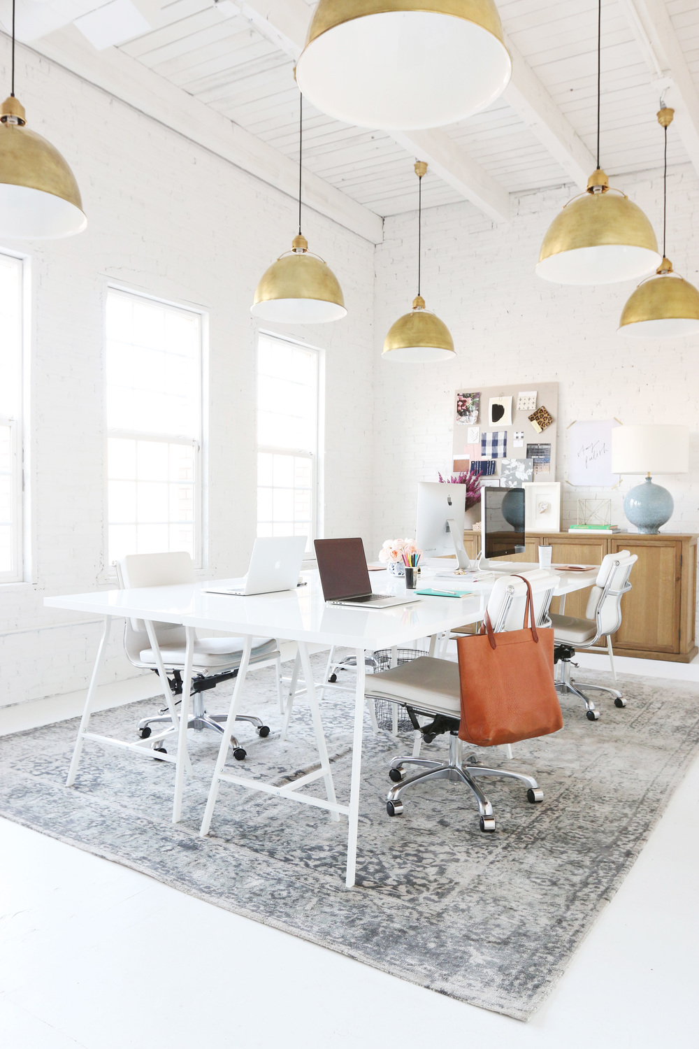 large white office space with gold pendant lights
