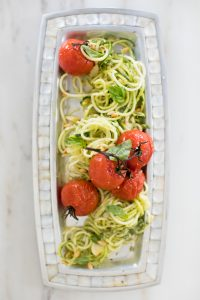platted noodles with tomatoes