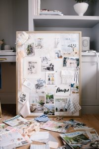 magazine cut outs, fabric swatches, and the DIY pin board behind