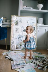 Lillya playing with magazine cut outs