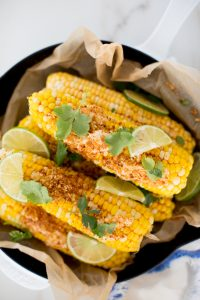 a pan of cilantro chipotle lime Mexican corn on the cob
