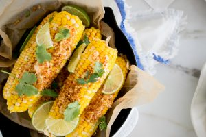 a pan of cilantro chipotle lime corn on the cob