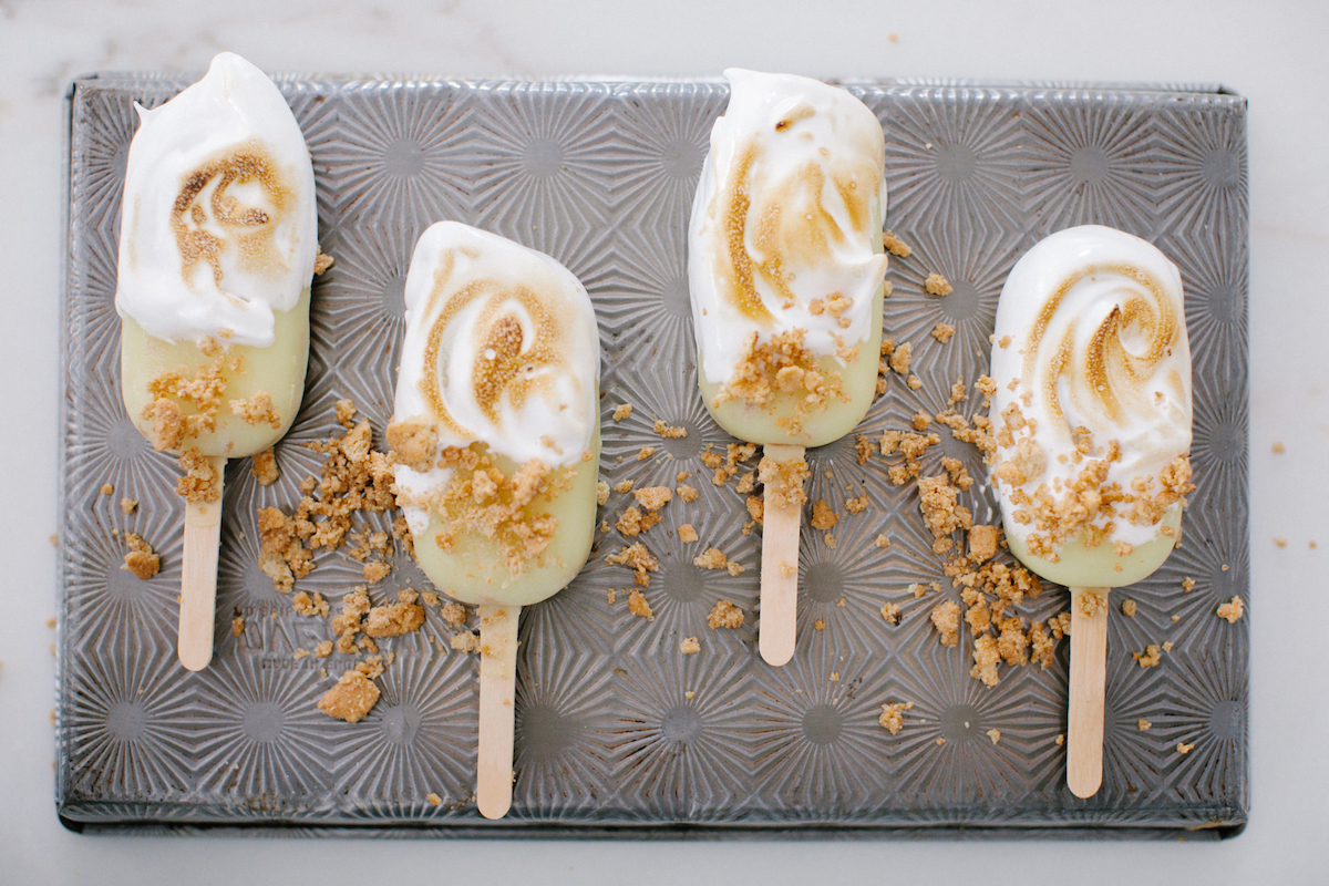 lemon meringue popsicles on a pan