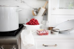 canning supplies and washed raspberries