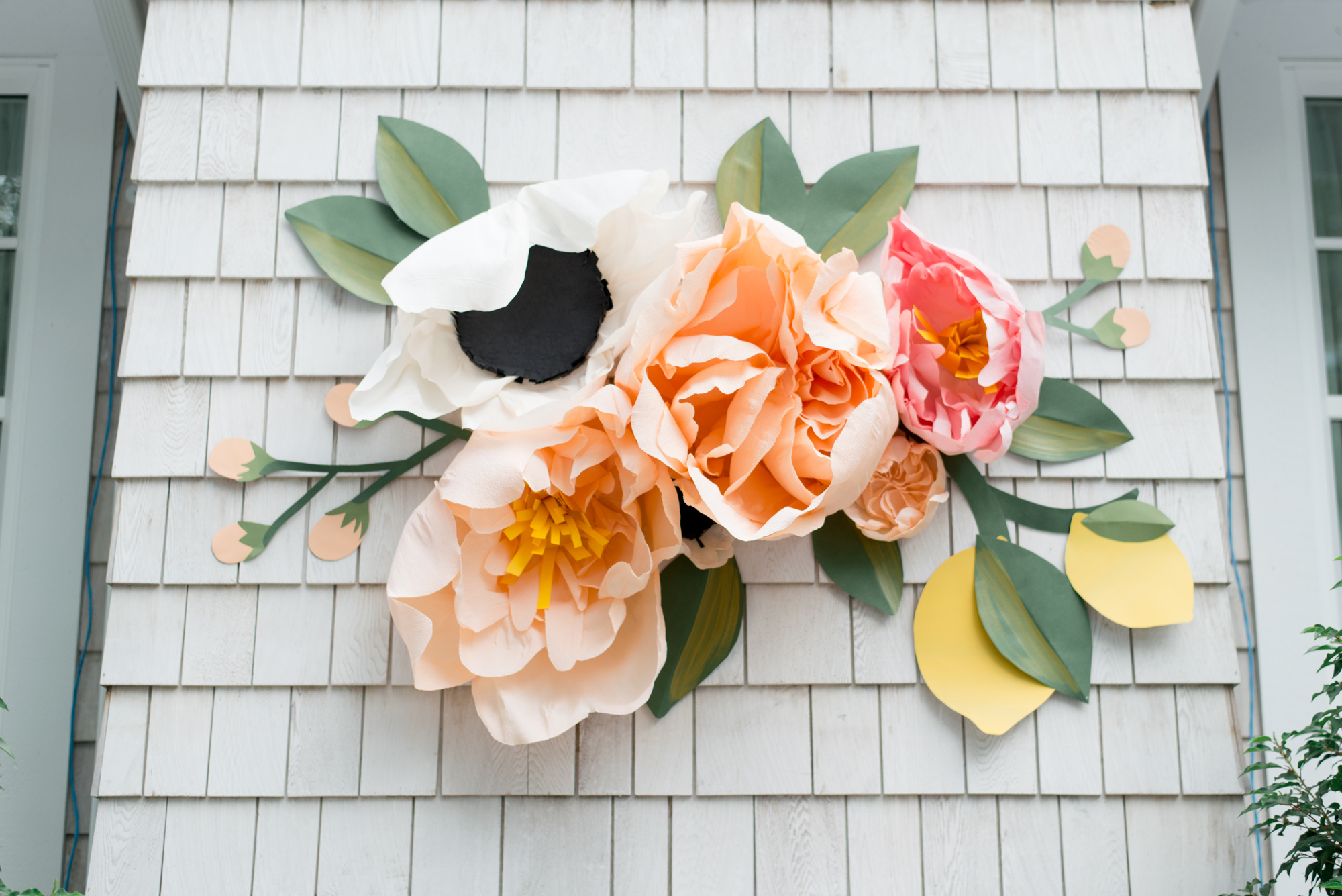 paper flower centre piece above outdoor fireplace