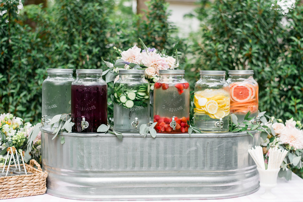 six jugs of infused water in the garden