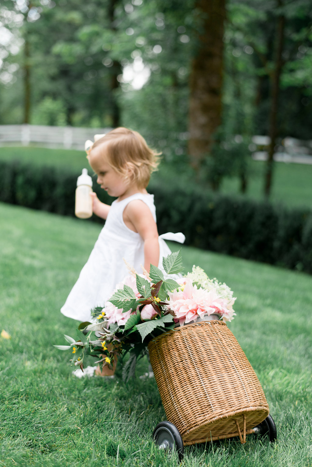 Lillya pulling a woven basket with fresh flowers