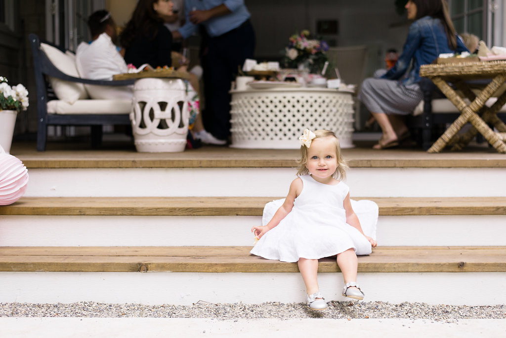 Lillya's sitting on outdoor patio steps