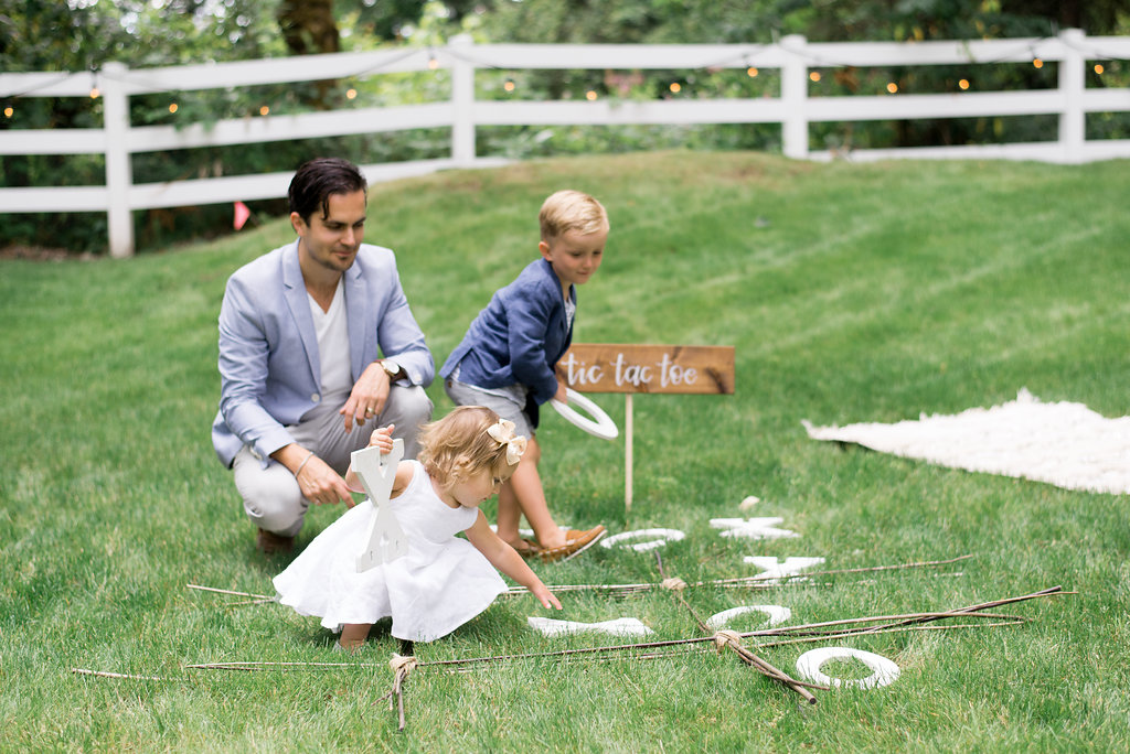 Troy and the kids playing tic tac toe in the garden