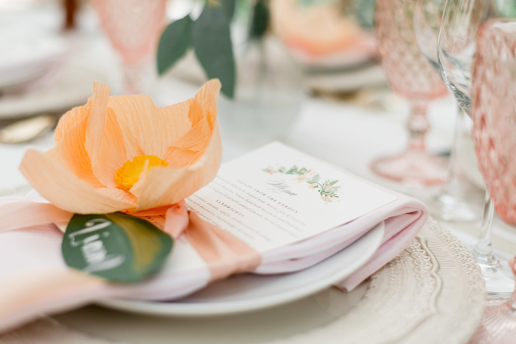 paper flowers wrapped around napkin and menu