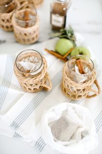 wicker mugs, apple and tea
