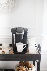 Black keurig coffee machine on bar cart