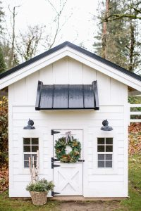 outdoor playhouse with wreath