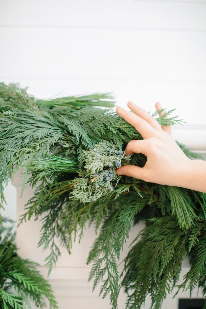 adding juniper into garland on mantel