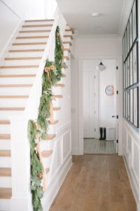 entryway with garland on banister