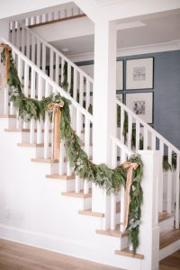 stairs with garland on banister with bows