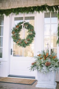 front door with cedar rope, winter planter box and wreath