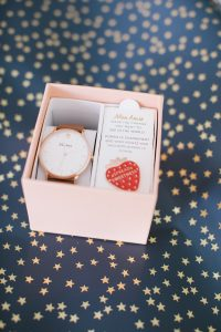 watch in box with strawberry pin