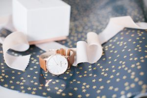 watch on star wrapping paper with ribbon
