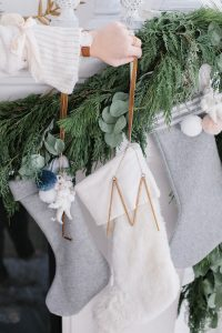 stocking be hung by fireplace with brown leather watch