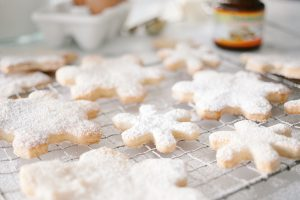 snowflake cookies on cooling rack