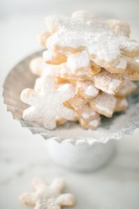 snowflake cookies on cookie stand