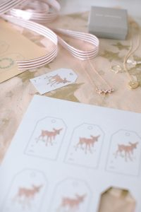Deer tag printable, necklaces on star tissue paper
