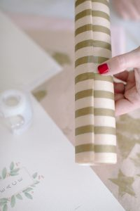 tapping tissue paper around craft tube