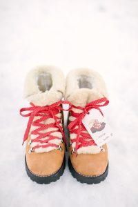 boots on snow with red laces
