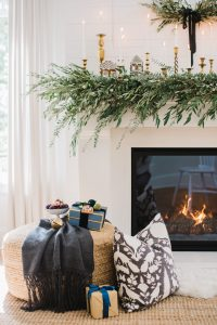 fireplace set up with gingerbread house on mantels