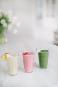 smoothies on counter in a row
