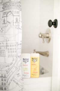 Paris shower curtain with body wash on side of tub
