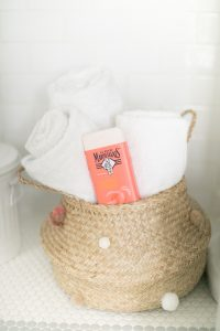 belly basket with pom pom towels and body wash