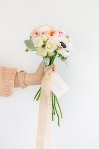 Hand holding bouquet
