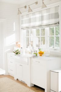 airy and bright kitchen window sink with roman blind