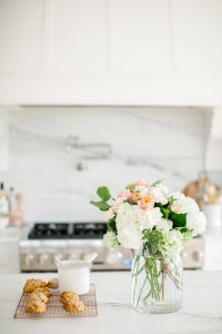 florals and scones in bright white kitchen