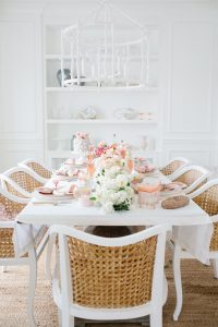 White dinning room with ombre florals on set table