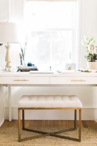 White desk with gold bench