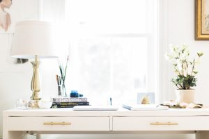 White desk with lamp and florals