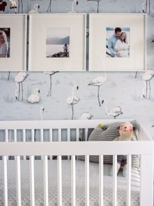 baby nursery with blue flamingo wallpaper