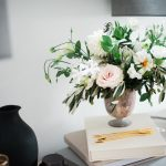 Floral arrangement on books