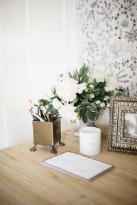 Florals and stationary on desk