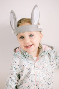 little girl with bunny ear headband
