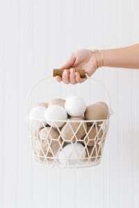 paper mâché eggs in basket