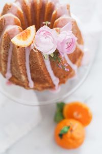 bunt cake with flowers and pink citrus glaze