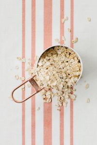 oats in copper measuring cup