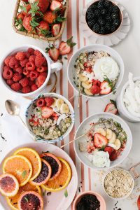 pretty oats bows with fruit on table